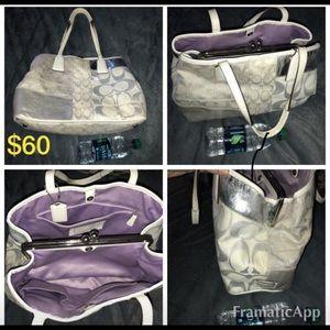 White and silver Coach purse